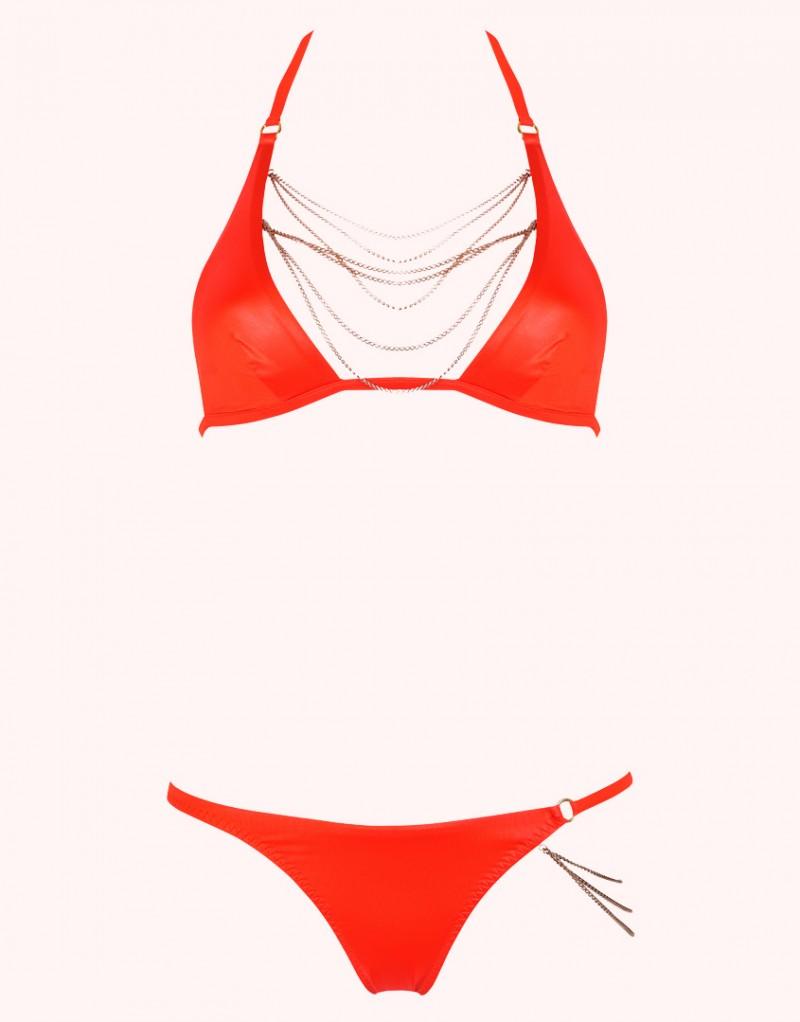 Плавки TonyaБикини<br>Встретив ее однажды, вы никогда ее не забудете - Tonya создана быть королевой пляжа!&amp;nbsp;Яркие оранжевые плавки из тонкой переливающейся ткани украшены элегантной драпировкой из золотистых отстегивающихся цепочек на бедре. Сочетайте с бюстгальтером купальника Tonya для создания незабываемого образа.<br><br>Возраст: Взрослый<br>Размер unitSize=: None<br>Цвет: оранжевый<br>Пол: Женское<br>Материал: основной состав: 89% полиамид 11% эластан подкладка: 82% полиамид 18% эластан