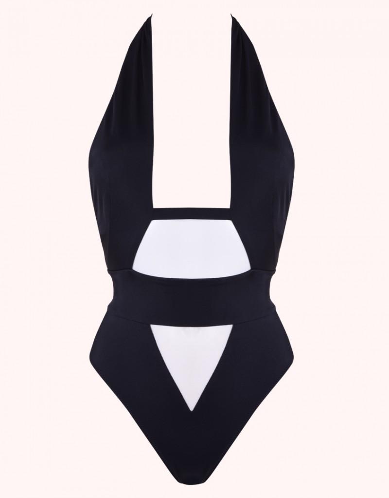 Купальник AnjaСлитные купальники<br>Anja &amp;ndash; сочетание современной эстетики и откровенной сексуальности. Черный слитный&amp;nbsp;купальник поразительно подчеркивает фигуру. <br><br>Высокая линия бедер визуально удлиняет&amp;nbsp;ноги. Перекрещивающиеся лямки формируют соблазнительный вырез в зоне декольте.&amp;nbsp;Широкий пояс застегивается сзади на золотистые крючки. Треугольная прозрачная вставка на&amp;nbsp;животе, небольшой вырез сзади на талии и слегка присборенные плавки завершают образ.<br><br>Возраст: Взрослый<br>Размер unitSize=: M (3 AP)<br>Цвет: черный<br>Пол: Женское