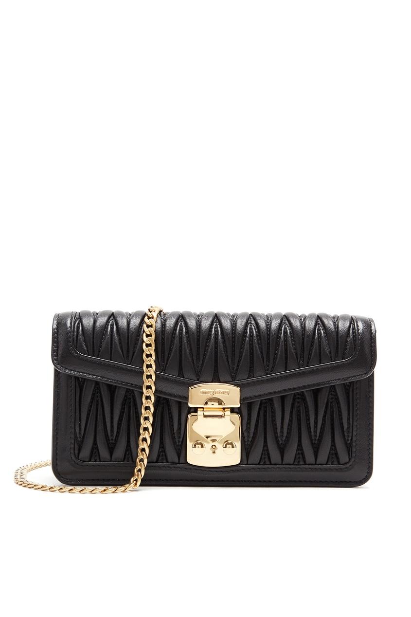 Купить Черная мини-сумка из стеганой кожи от Miu Miu черного цвета