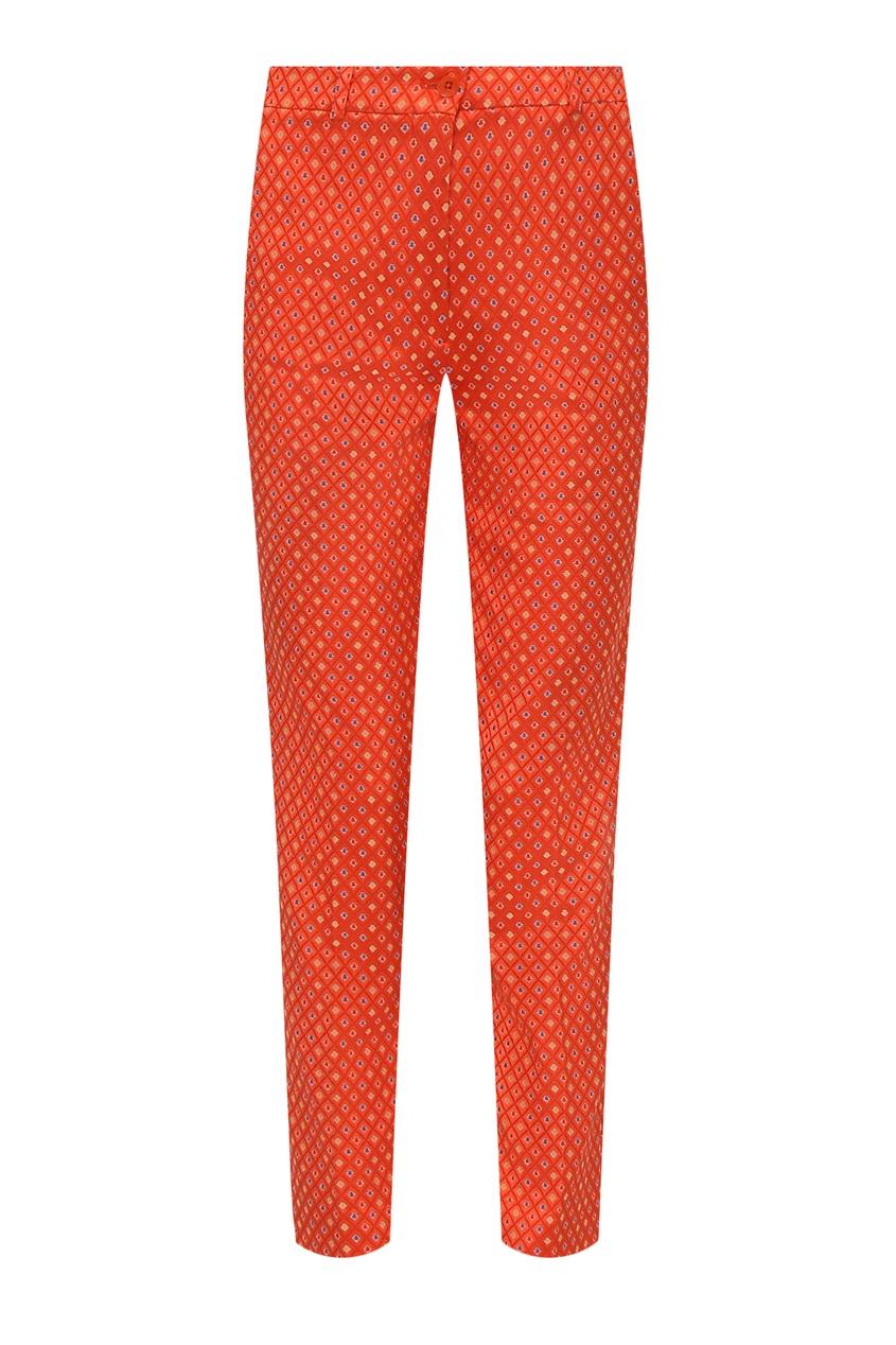 Фото - Оранжевые брюки с узором от Etro красного цвета