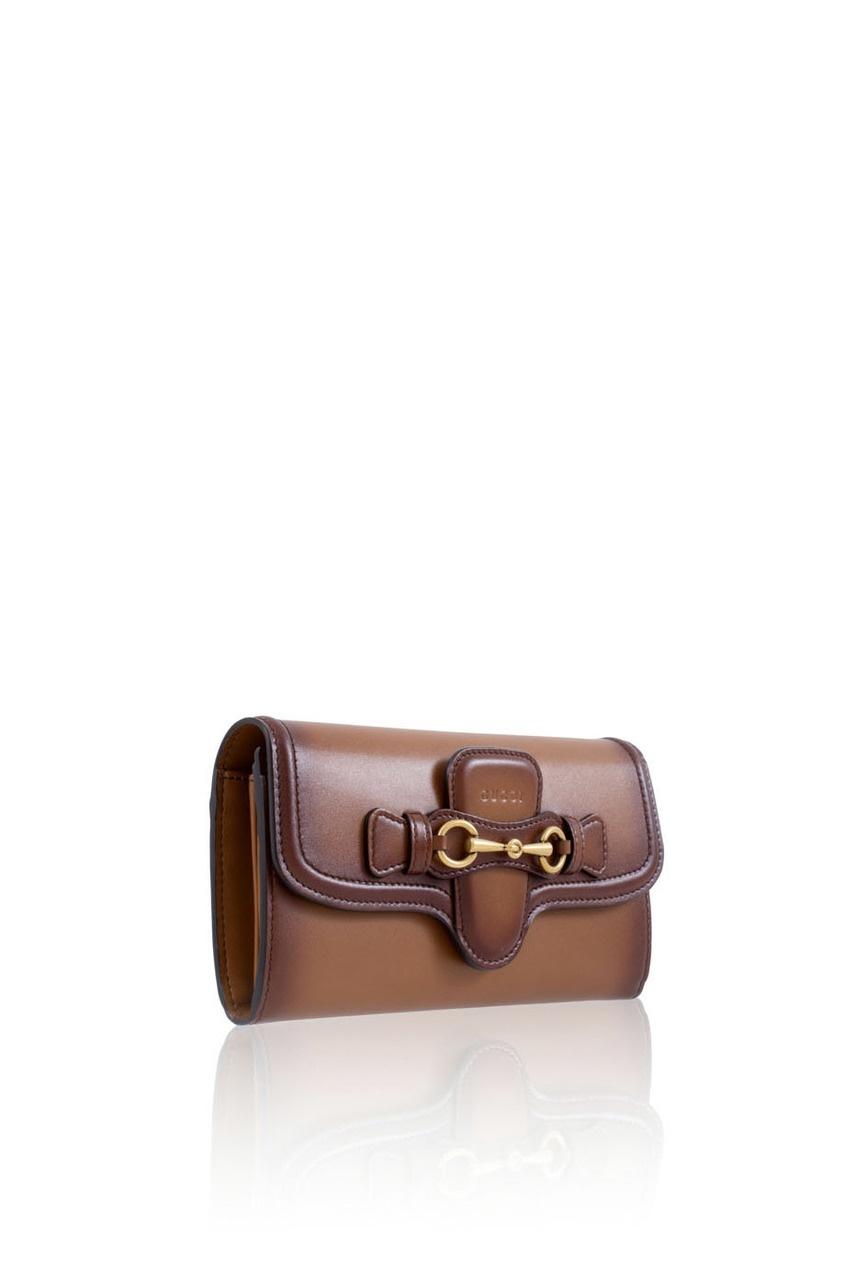 Фото 4 - Кожаный кошелек Lady Web от Gucci коричневого цвета