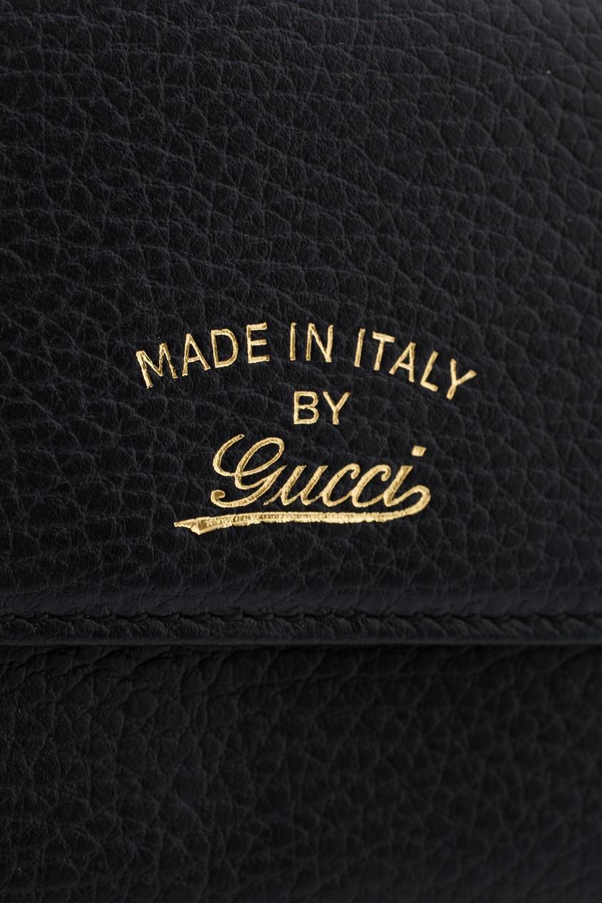 Фото 4 - Кожаный кошелек от Gucci черного цвета