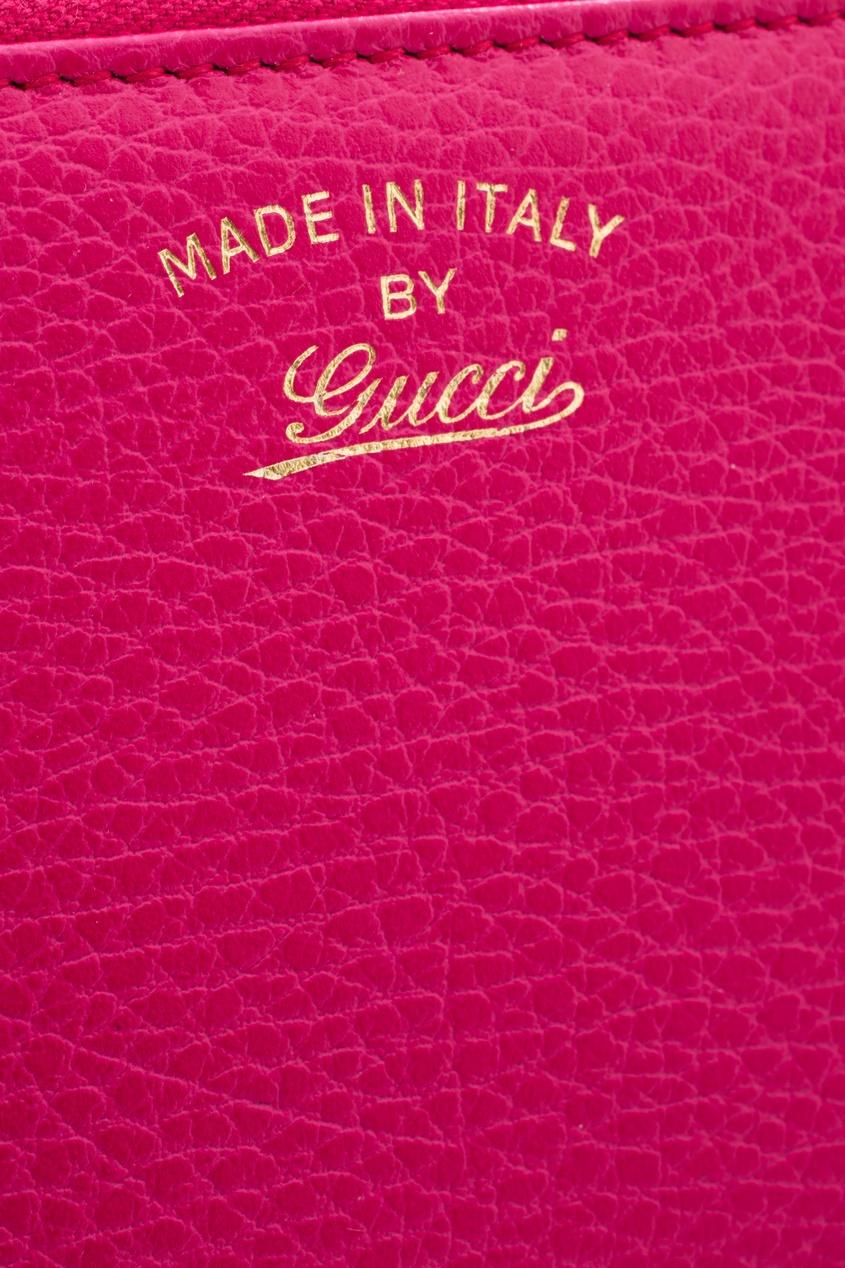 Фото 2 - Кожаный кошелек от Gucci красного цвета