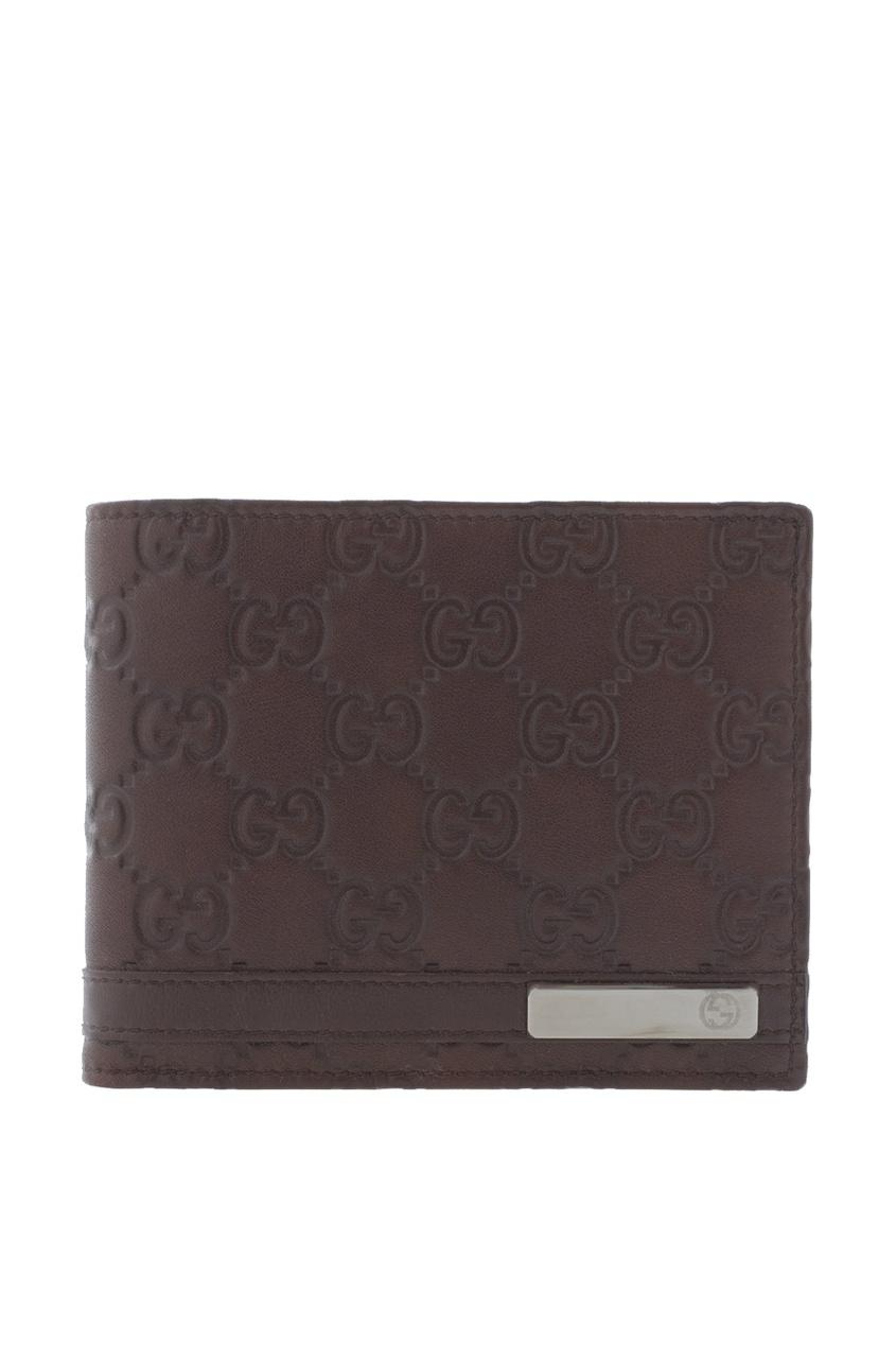 Фото - Кожаный бумажник от Gucci коричневого цвета