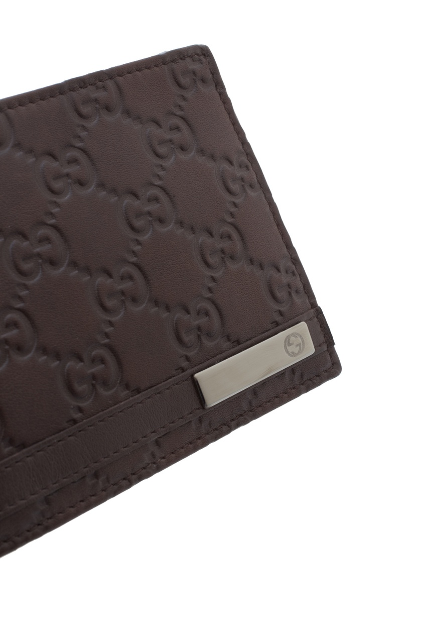 Фото 4 - Кожаный бумажник от Gucci коричневого цвета