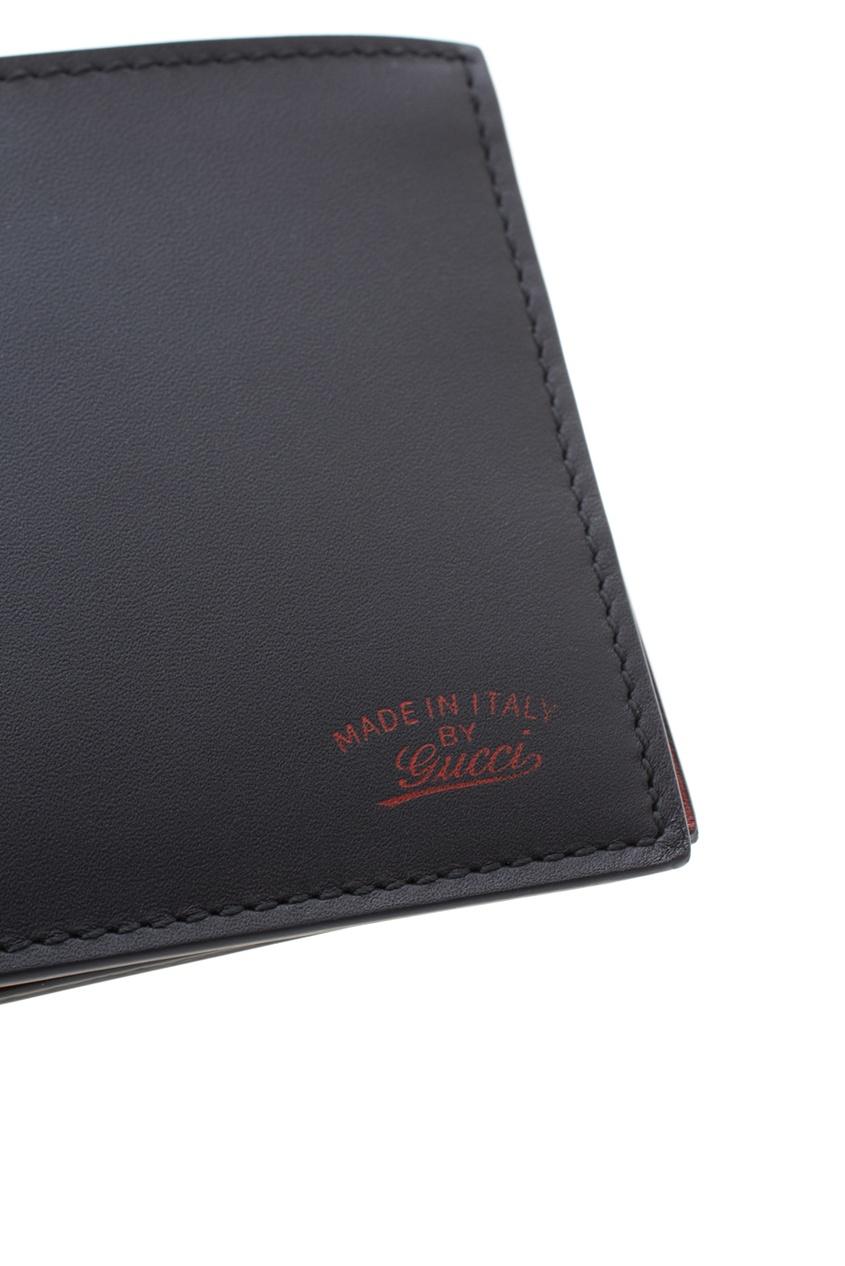 Фото 4 - Кожаный бумажник от Gucci черного цвета