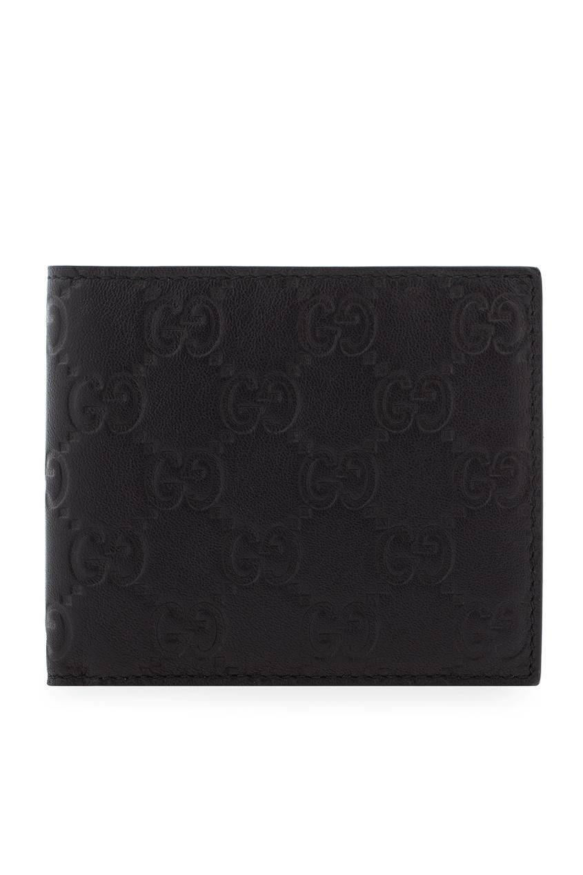 Фото - Кожаный бумажник от Gucci черного цвета