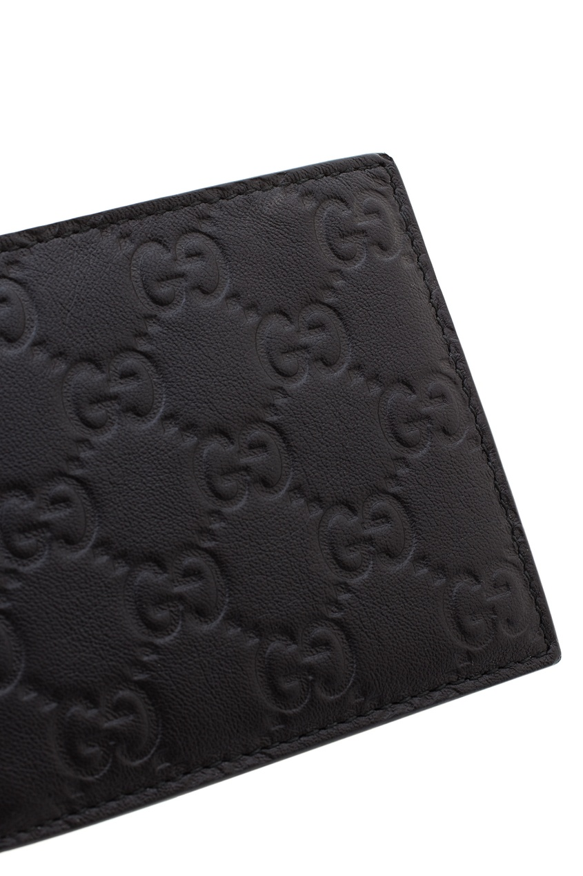 Фото 3 - Кожаный бумажник от Gucci черного цвета