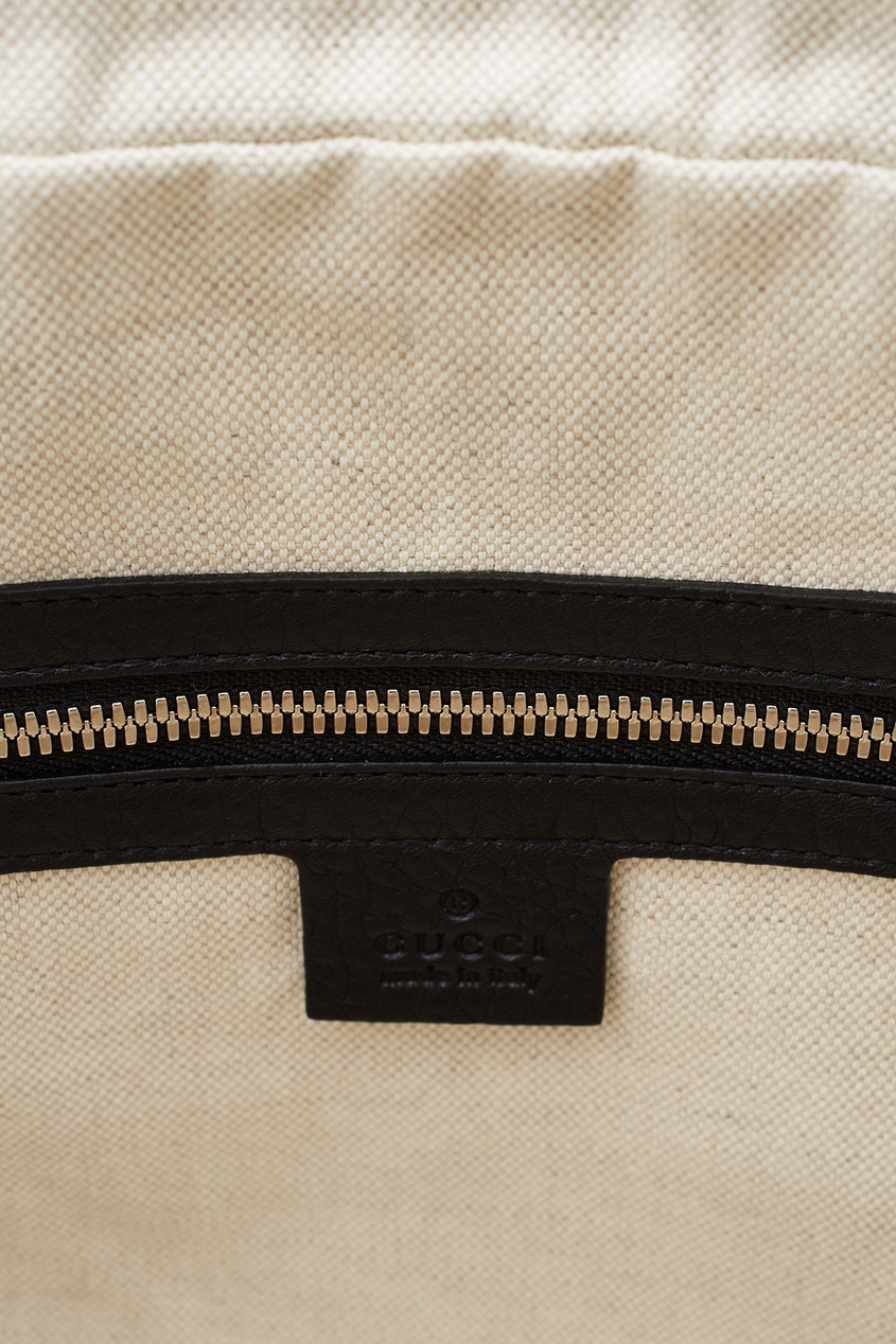 Фото 6 - Кожаная сумка от Gucci черного цвета