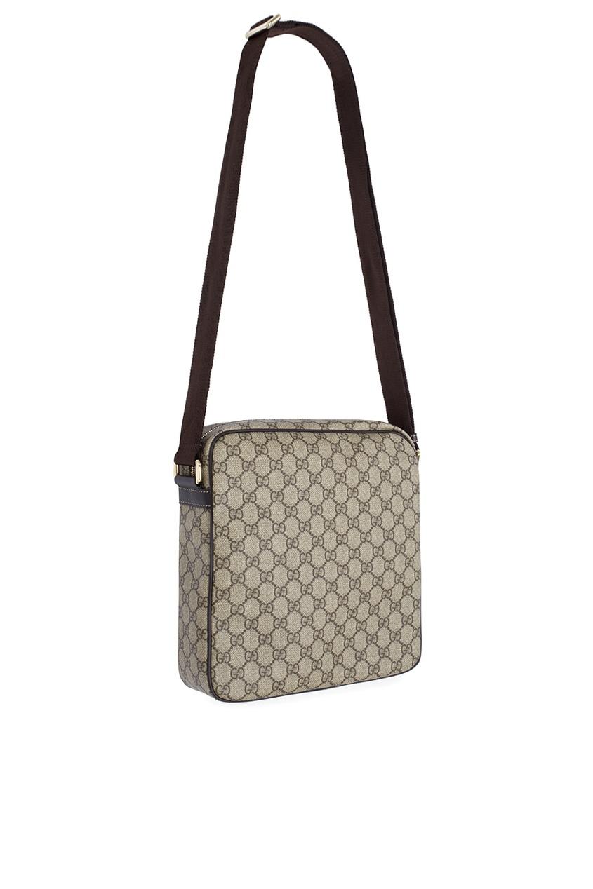 Фото 2 - Кожаная сумка от Gucci бежевого цвета