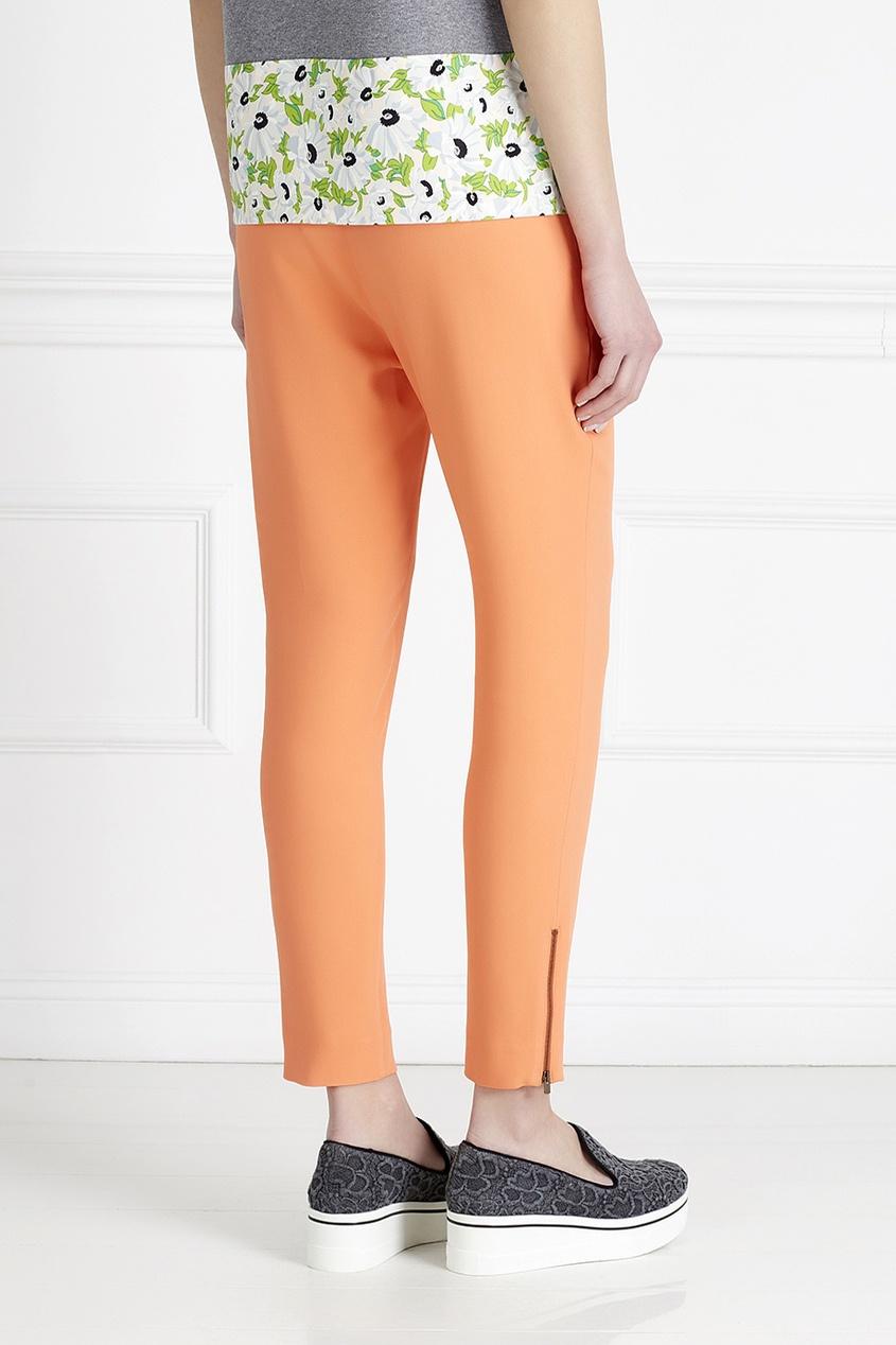Фото 6 - Однотонные брюки от Stella McCartney оранжевого цвета