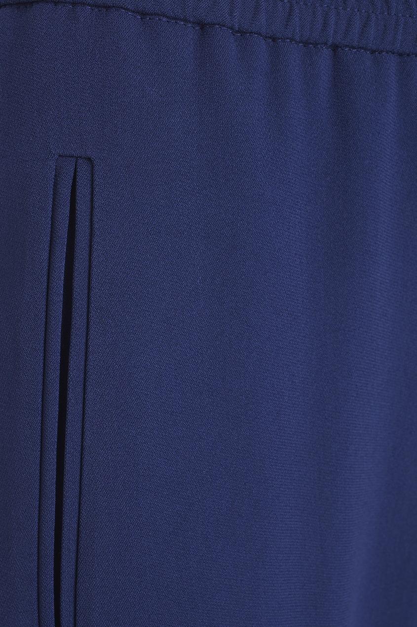 Фото 6 - Однотонные брюки от Stella McCartney синего цвета