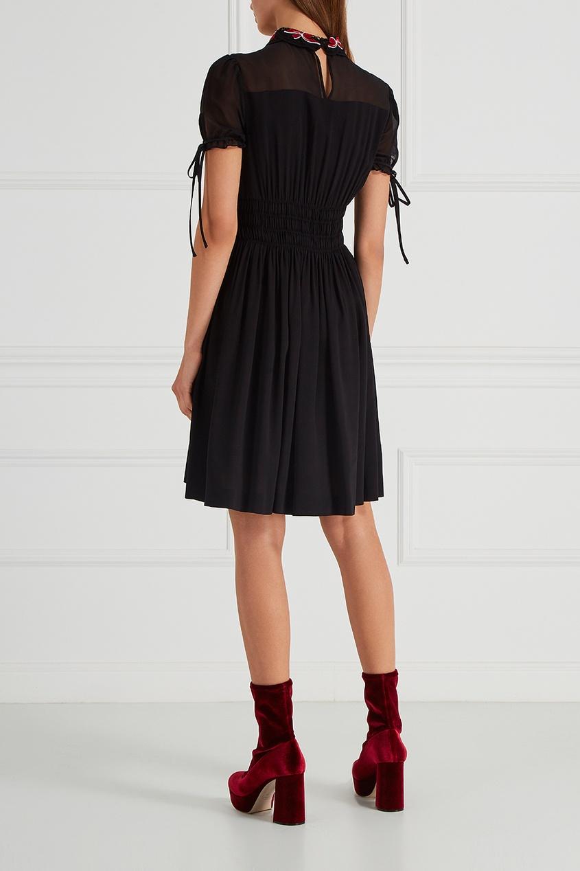 Черное платье с драпировками