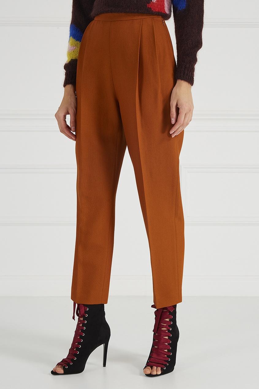 Оранжевые брюки со складками