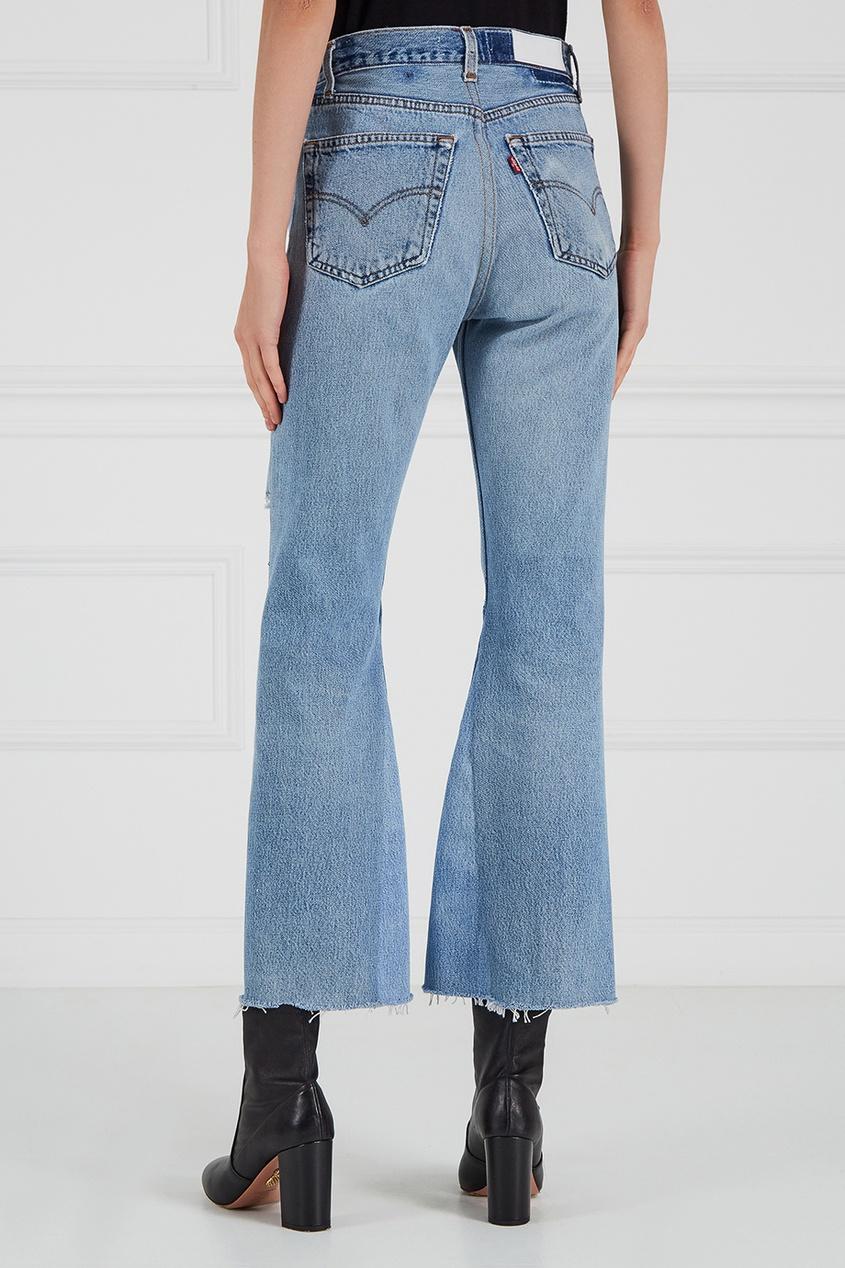 Прямые джинсы со сквозным разрывом