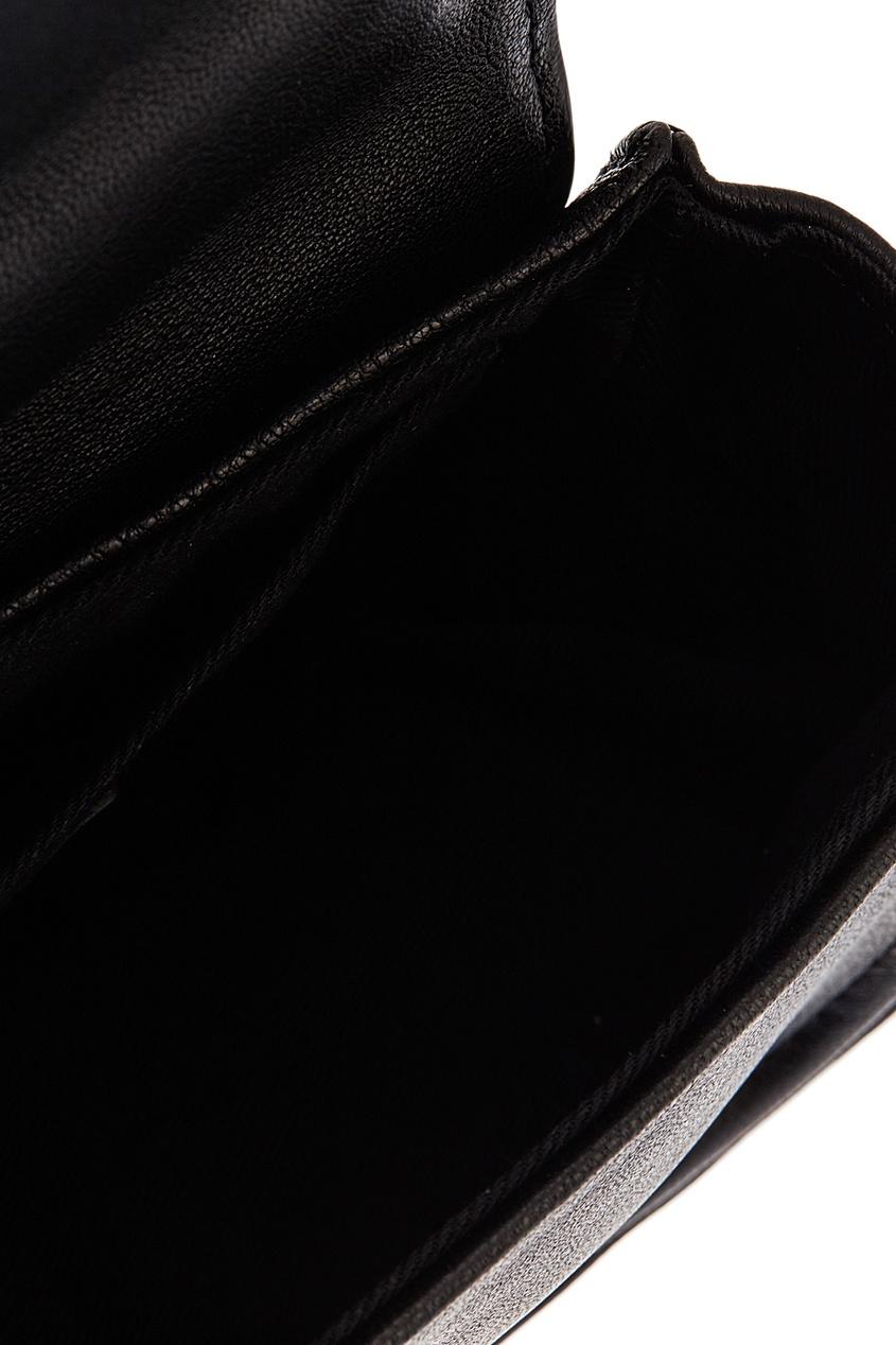 Фото #1: Черная кожаная сумка на цепочке