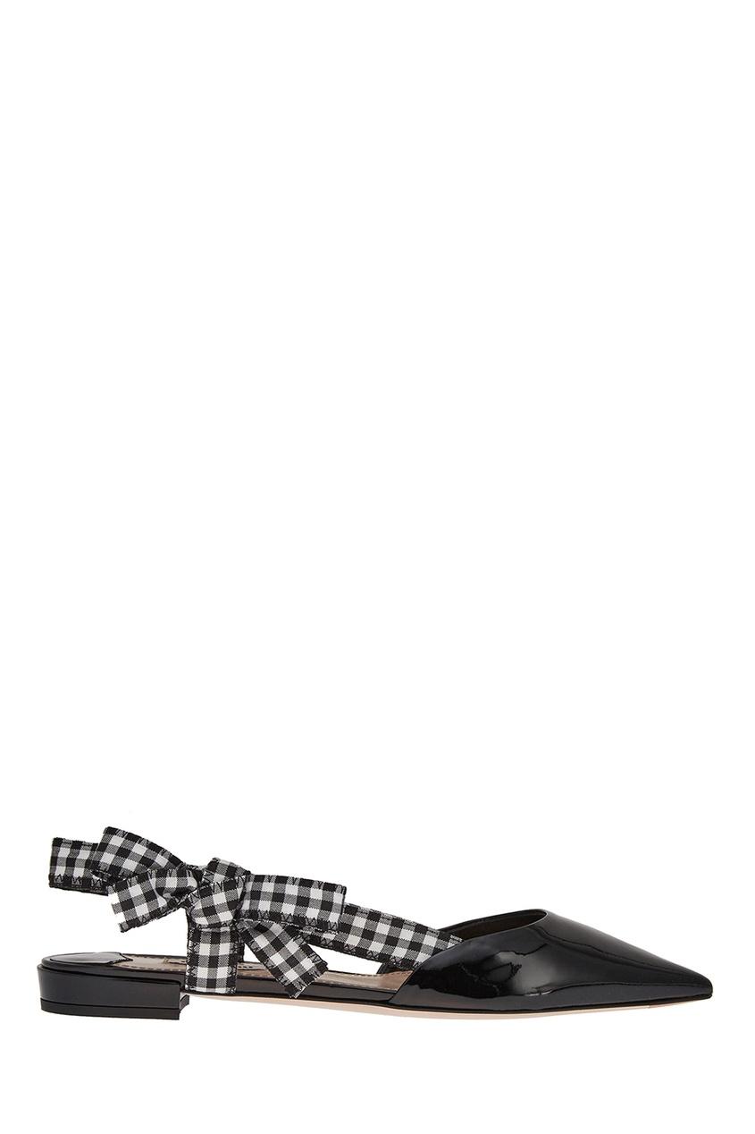 Черные лакированные туфли с бантами