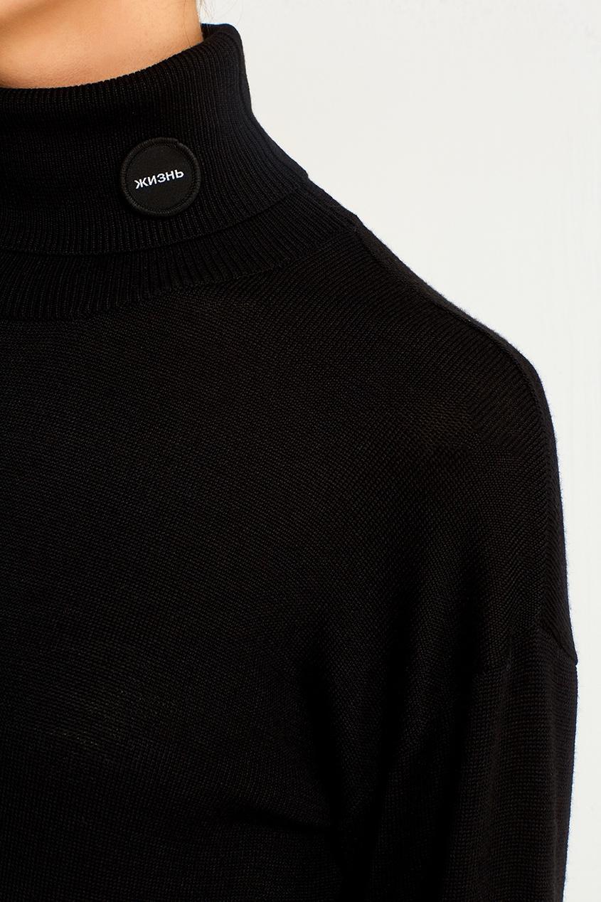 Удлиненный свитер черного цвета