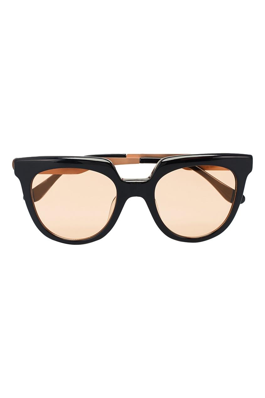 Черные очки с золотистыми линзами