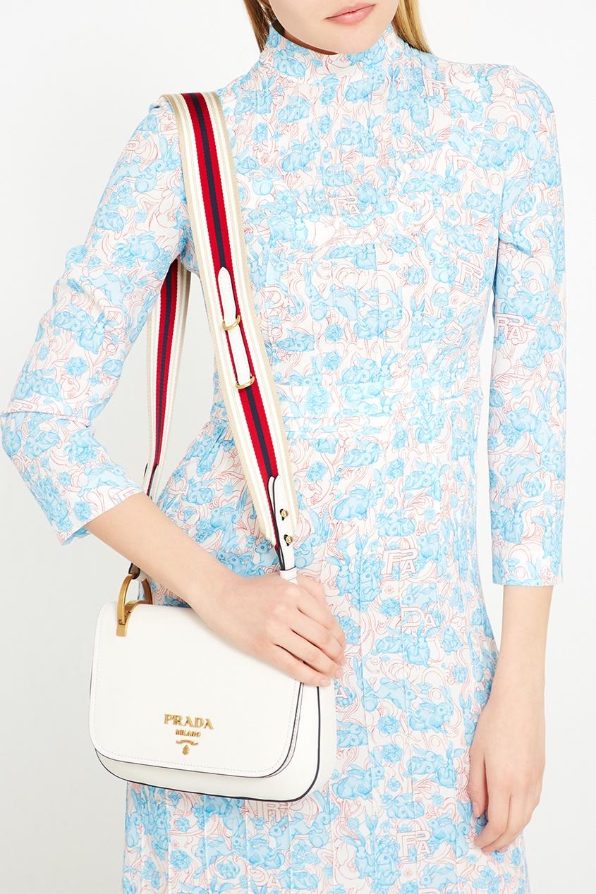 Белая кожаная сумка на текстильном ремне