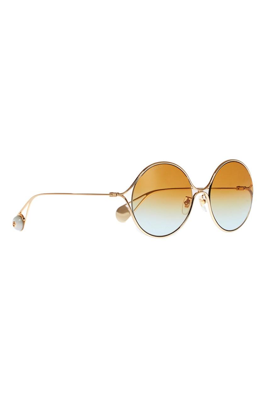 Круглые очки в золотистой оправе