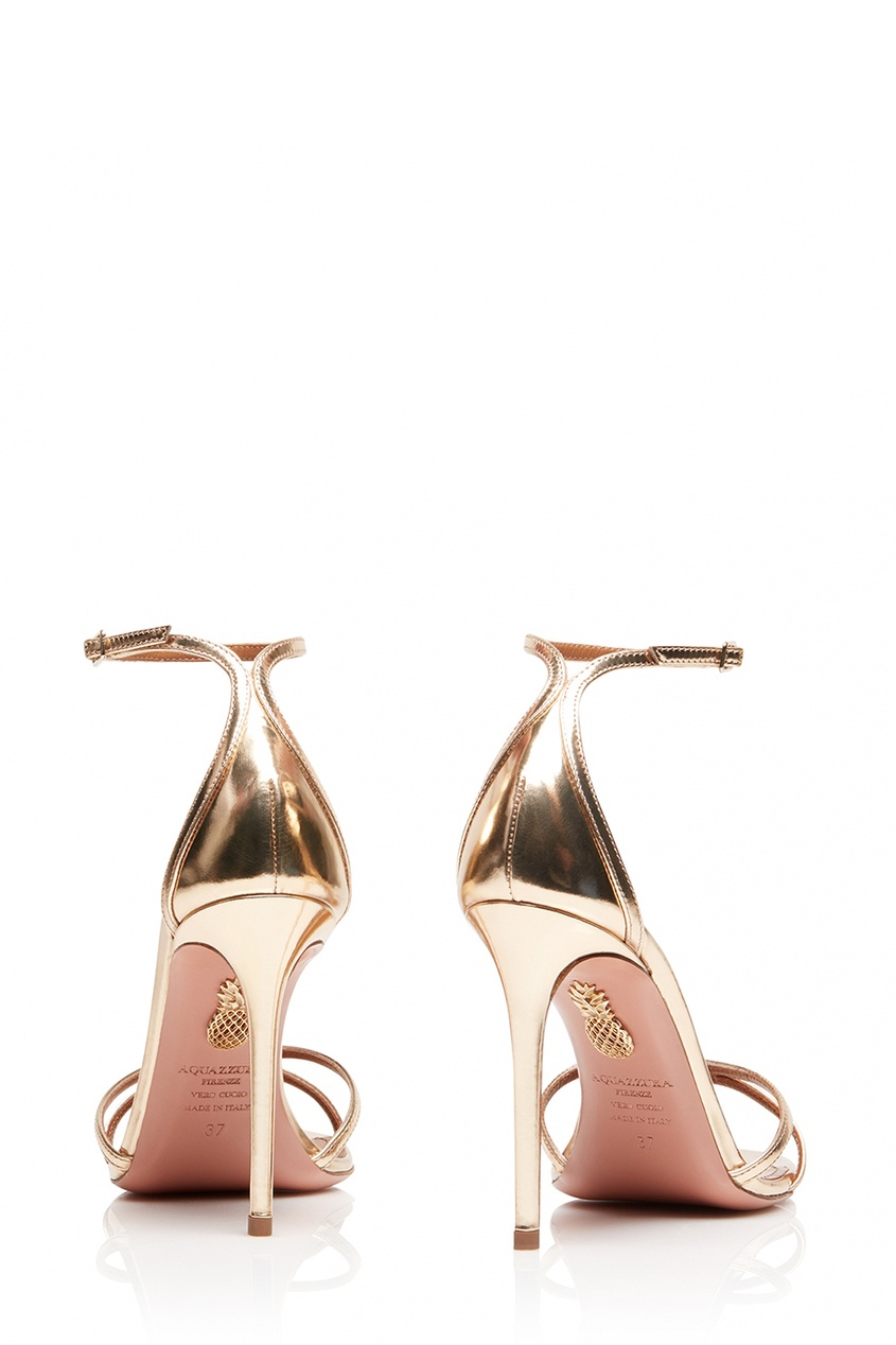 Золотистые босоножки Purist Sandal 105 от Aquazzura