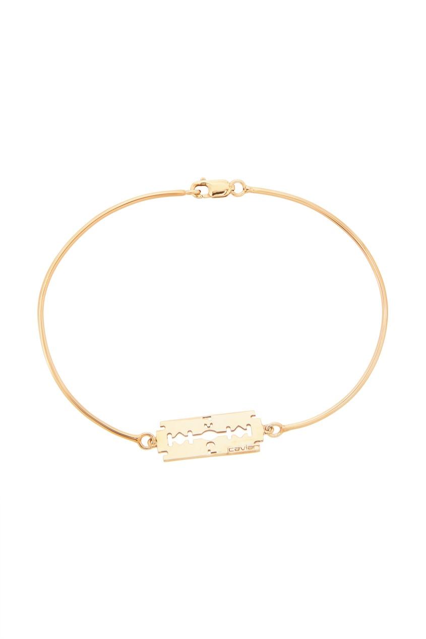 Золотистый браслет с лезвием