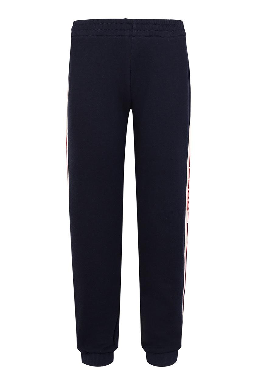 Купить Темно-синие брюки с лампасами от Gucci Kids синего цвета