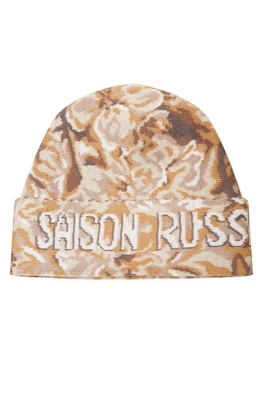 Бежево-коричневая шапка с узором и надписью