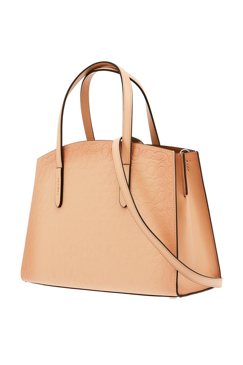 Фото 5 - Бежевая сумка-тоут с монограммами от Coach бежевого цвета