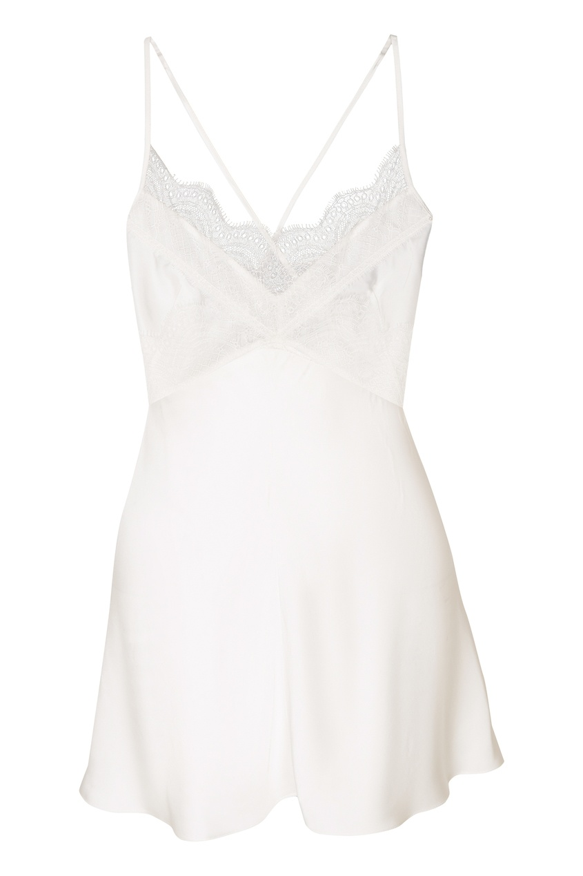 Фото - Белая туника с кружевной отделкой от Victoria Beckham белого цвета