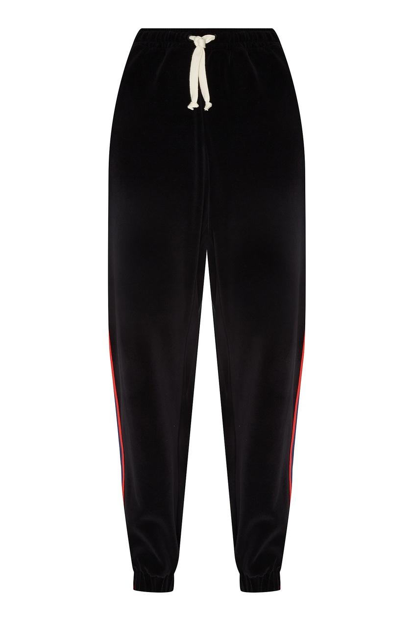 Фото - Черные брюки с трехцветными лампасами от Gucci Man черного цвета